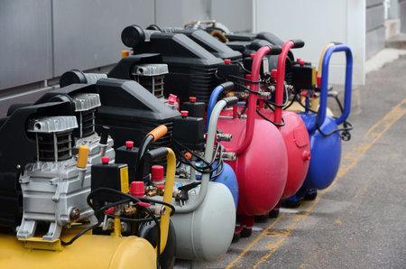 Many new air compressors pressure pumps close up photo