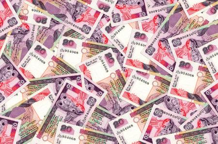 20 Sri Lankan rupees bills lies in big pile. Rich life conceptual background. Big amount of money