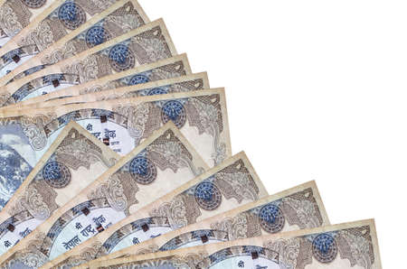 500 Nepalese rupees bills lies isolated on white background with copy space stacked in fan close up. Payday time concept or financial operations
