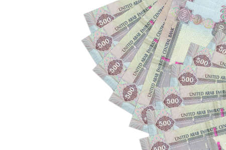 500 UAE dirhams bills lies isolated on white background with copy space. Rich life conceptual background. Big amount of national currency wealth