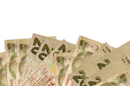 20 Turkish liras bills lies on bottom side of screen isolated on white background with copy space. Background banner template for business concepts with money
