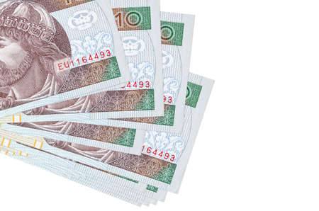 10 Polish zloty bills lies in small bunch or pack isolated on white. Mockup with copy space. Business and currency exchange concept