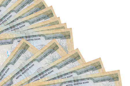 100 Nepalese rupees bills lies isolated on white background with copy space stacked in fan close up. Payday time concept or financial operations