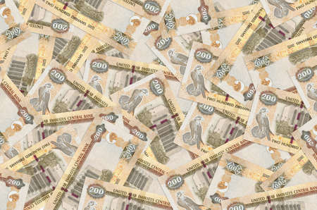 200 UAE dirhams bills lies in big pile. Rich life conceptual background. Big amount of money Stock fotó
