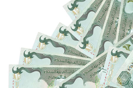 10 UAE dirhams bills lies in different order isolated on white. Local banking or money making concept. Business background banner