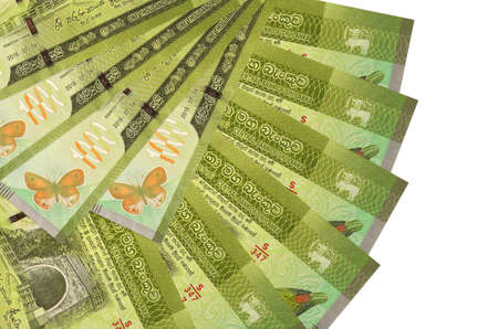 1000 Sri Lankan rupees bills lies isolated on white background with copy space stacked in fan shape close up. Financial transactions concept