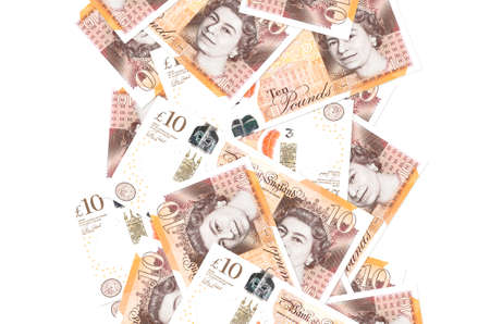 10 British pounds bills flying down isolated on white. Many banknotes falling with white copy space on left and right side Banque d'images