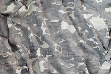Camouflage background texture as backdrop for russian air forces design projects. Back side of troopers camouflage jacket with many pleats on crumpled fabric 写真素材
