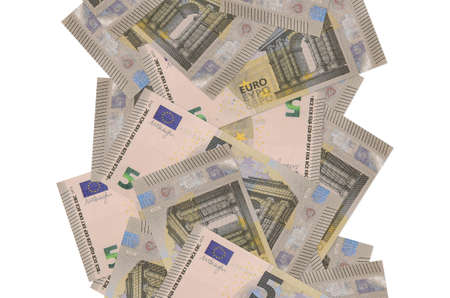 5 euro bills flying down isolated on white. Many banknotes falling with white copy space on left and right side