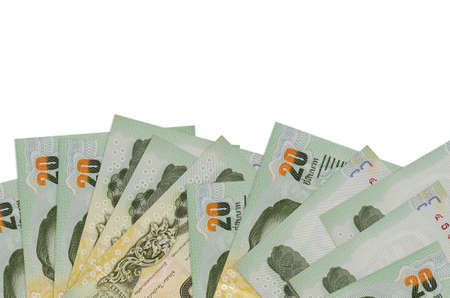 20 Thai Baht bills lies on bottom side of screen isolated on white background with copy space. Background banner template for business concepts with money