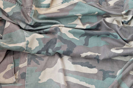 Camouflage background texture as backdrop for russian or ussr snipers design projects. Back side of snipers camouflage jacket with many pleats on crumpled fabric