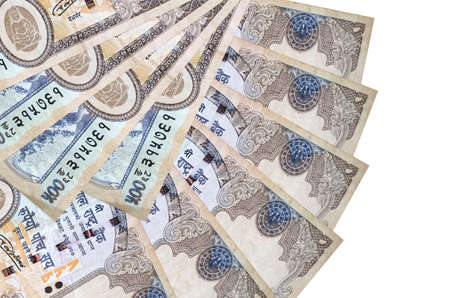 500 Nepalese rupees bills lies isolated on white background with copy space stacked in fan shape close up. Financial transactions concept