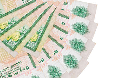 10 Sri Lankan rupees bills lies isolated on white background with copy space stacked in fan shape close up. Financial transactions concept