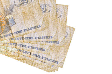 25 Egyptian piastres bills lies in small bunch or pack isolated on white. Mockup with copy space. Business and currency exchange concept