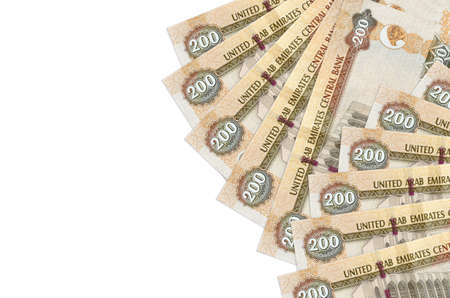 200 UAE dirhams bills lies isolated on white background with copy space. Rich life conceptual background. Big amount of national currency wealth