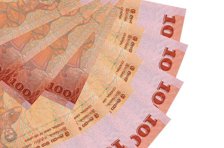 100 Sri Lankan rupees bills lies isolated on white background with copy space stacked in fan shape close up. Financial transactions concept
