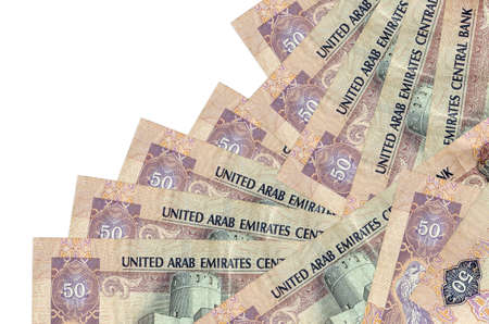 50 UAE dirhams bills lies in different order isolated on white. Local banking or money making concept. Business background banner