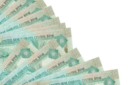 10 UAE dirhams bills lies isolated on white background with copy space stacked in fan close up. Payday time concept or financial operations Stock fotó