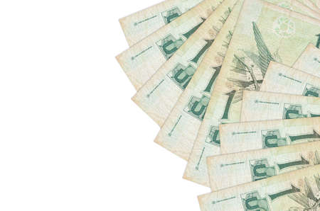 1 Brazilian real bills lies isolated on white background with copy space. Rich life conceptual background. Big amount of national currency wealth Zdjęcie Seryjne