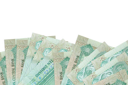 10 UAE dirhams bills lies on bottom side of screen isolated on white background with copy space. Background banner template for business concepts with money Stock fotó