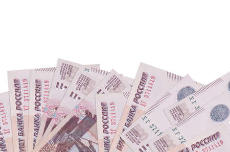 500 russian rubles bills lies on bottom side of screen isolated on white background with copy space. Background banner template for business concepts with money