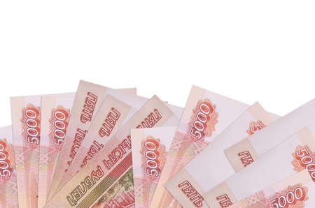 5000 russian rubles bills lies on bottom side of screen isolated on white background with copy space. Background banner template for business concepts with money