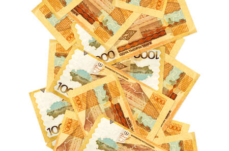 1000 Kazakhstani tenge bills flying down isolated on white. Many banknotes falling with white copy space on left and right side