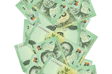 20 Thai Baht bills flying down isolated on white. Many banknotes falling with white copy space on left and right side
