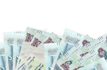 500 UAE dirhams bills lies on bottom side of screen isolated on white background with copy space. Background banner template for business concepts with money