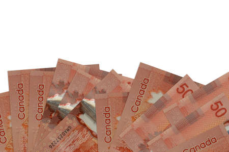 50 Canadian dollars bills lies on bottom side of screen isolated on white background with copy space. Background banner template for business concepts with money