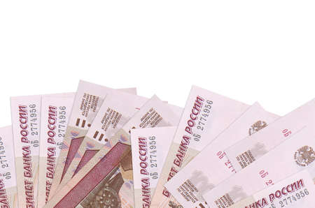 100 russian rubles bills lies on bottom side of screen isolated on white background with copy space. Background banner template for business concepts with money