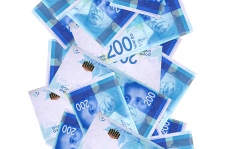 200 Israeli new shekels bills flying down isolated on white. Many banknotes falling with white copy space on left and right side