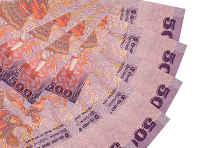 500 Sri Lankan rupees bills lies isolated on white background with copy space stacked in fan shape close up. Financial transactions concept