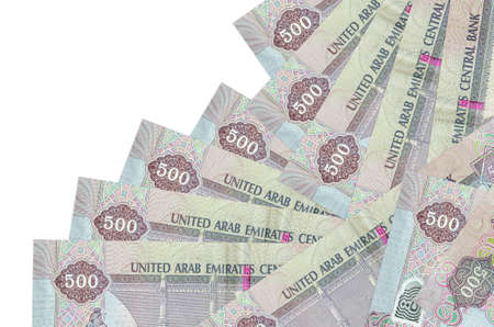 500 UAE dirhams bills lies in different order isolated on white. Local banking or money making concept. Business background banner Stock fotó