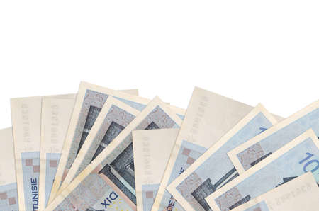 10 Tunisian dinars bills lies on bottom side of screen isolated on white background with copy space. Background banner template for business concepts with money