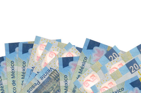 20 Mexican pesos bills lies on bottom side of screen isolated on white background with copy space. Background banner template for business concepts with money