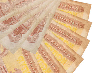 1 Ukrainian coupon bills lies isolated on white background with copy space stacked in fan shape close up. Financial transactions concept Фото со стока
