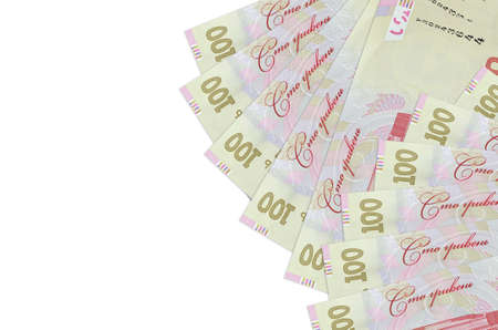 100 Ukrainian hryvnias bills lies isolated on white background with copy space. Rich life conceptual background. Big amount of national currency wealth Фото со стока