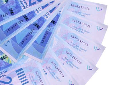 200 Israeli new shekels bills lies isolated on white background with copy space stacked in fan shape close up. Financial transactions concept