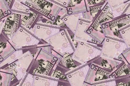 50 Dominican pesos bills lies in big pile. Rich life conceptual background. Big amount of money