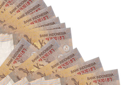 2000 Indonesian rupiah bills lies isolated on white background with copy space stacked in fan close up. Payday time concept or financial operations