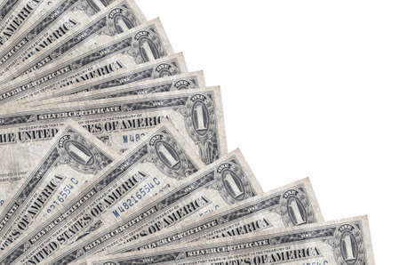 1 US dollar bills lies isolated on white background with copy space stacked in fan close up. Payday time concept or financial operations Фото со стока