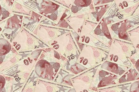 10 Turkish liras bills lies in big pile. Rich life conceptual background. Big amount of money Фото со стока