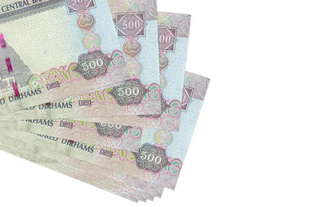 500 UAE dirhams bills lies in small bunch or pack isolated on white. Mockup with copy space. Business and currency exchange concept