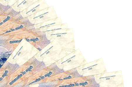 1000 Cambodian riels bills lies isolated on white background with copy space stacked in fan close up. Payday time concept or financial operations