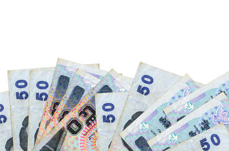 50 Thai Baht bills lies on bottom side of screen isolated on white background with copy space. Background banner template for business concepts with money