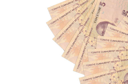 5 Turkish liras bills lies isolated on white background with copy space. Rich life conceptual background. Big amount of national currency wealth
