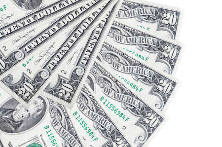 20 US dollars bills lies isolated on white background with copy space stacked in fan shape close up. Financial transactions concept Фото со стока