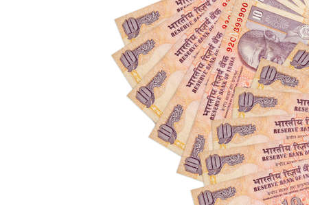 10 Indian rupees bills lies isolated on white background with copy space. Rich life conceptual background. Big amount of national currency wealth