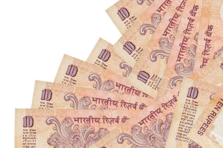 10 Indian rupees bills lies in different order isolated on white. Local banking or money making concept. Business background banner Фото со стока